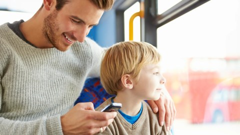 A father looking up on his phone how to mend his relationship with his child