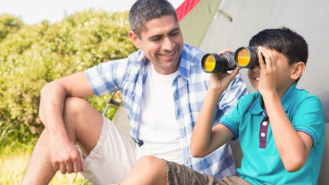 Father and son camping to take son's mind off school anxiety