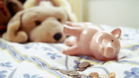 Piggy bank and coins as part of a reward system for kids