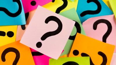 Question marks on sticky notes, representing the questions of ADHD and anxiety