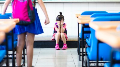 Young girl with ADHD and anxiety crying in class