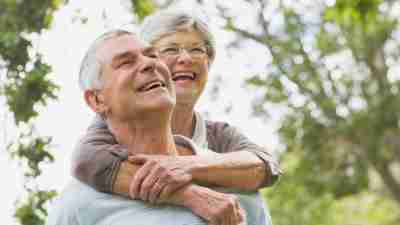 Elderly ADHD couple laughing and walking outside