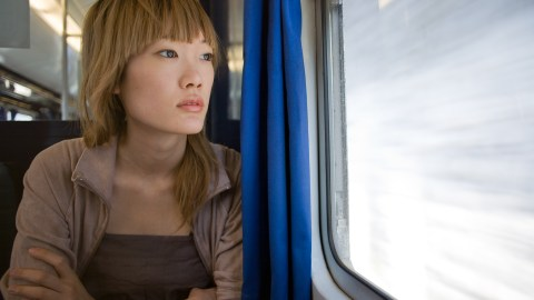 Woman with ADHD has anxiety and looks out the window.