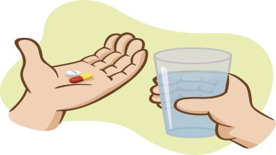 An ADHD boy holds pills in his hands