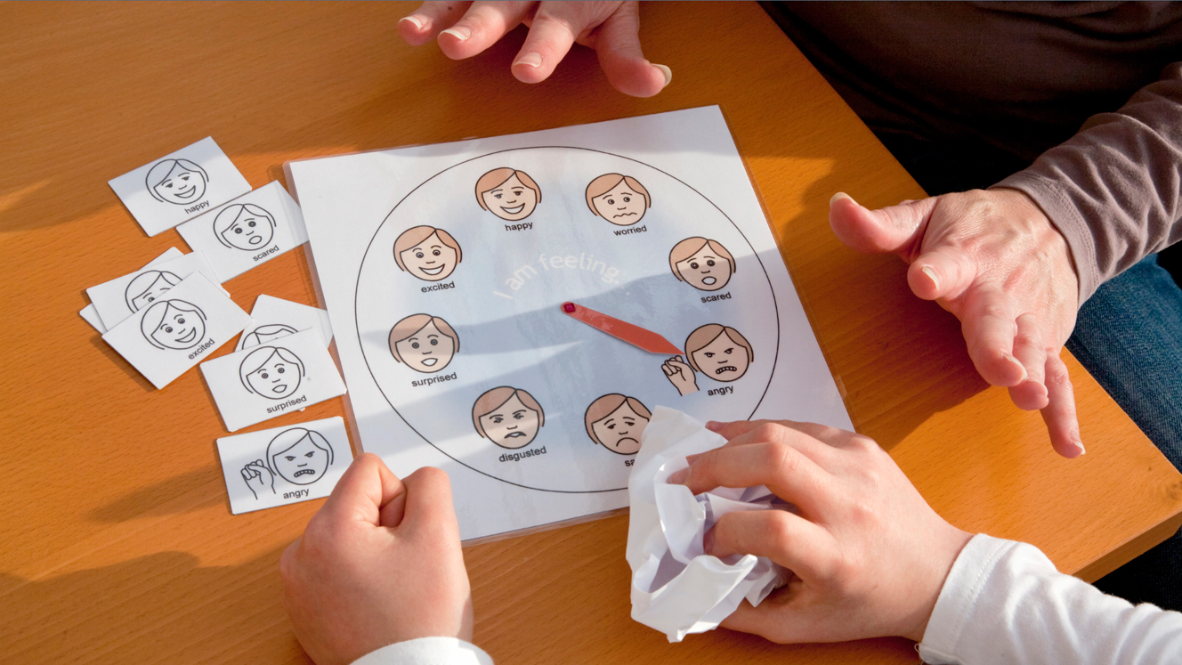 A child completes a test for autism and emotional control with a therapist
