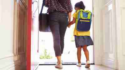 Close Up Of Mother And ADHD Daughter Leaving For School