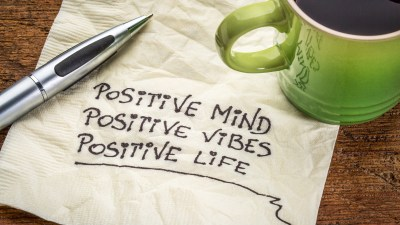positive mind, positive vibes, positive life - motivational handwriting on a napkin with a cup of coffee for ADHDers