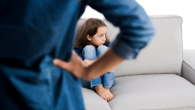Grown up rebuking a ADHD child for bad behavior