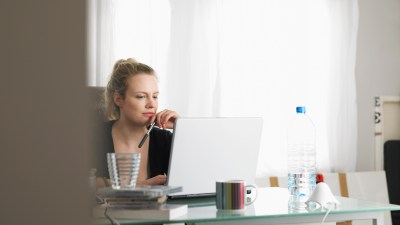 ADHD Woman using laptop sitting at office