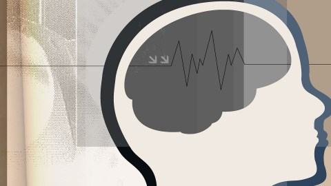 Illustration of a brain with brainwaves before neurofeedback training
