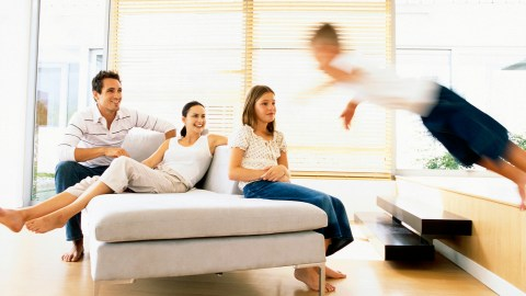 A hyperactive boy running around while his family sits on the couch; how they knew he had ADHD