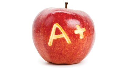 "An apple with ""A+"" carved into it by a child happy to be changing school"