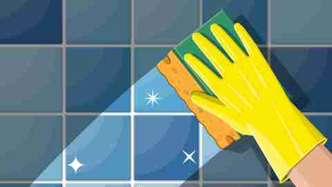 A hand in a yellow glove cleaning a shower wall, division of labor in marriage concept
