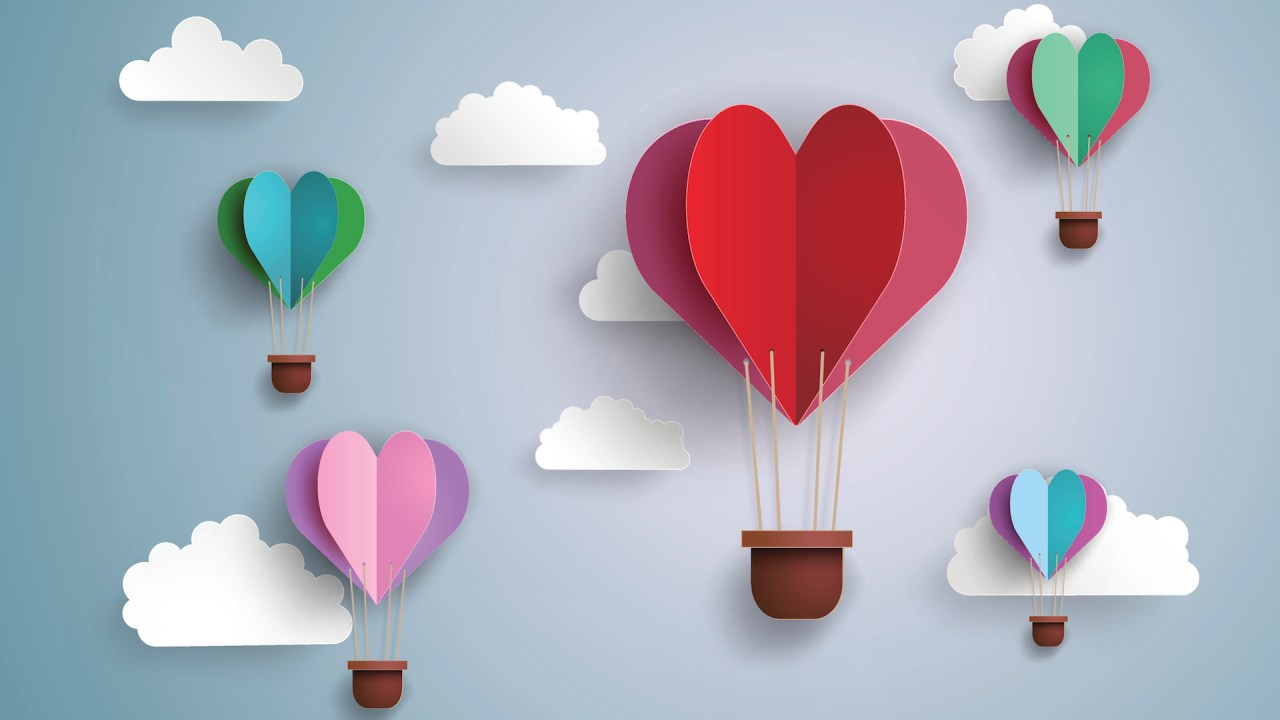 Heart-shaped hot air balloons made out of paper to illustrate statistics on marriage and ADHD