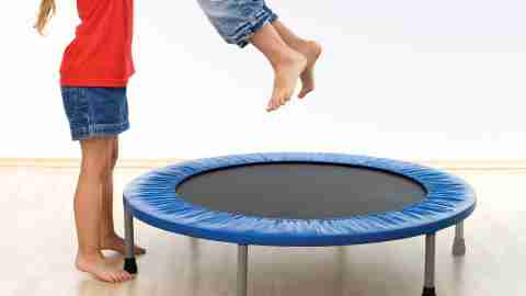 Children with ADHD and sensory processing disorder bouncing on a trampoline