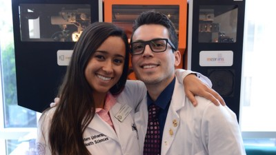 Chrystopher Perez, who has ADHD and is studying to be a dentist, with a friend from dental school