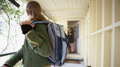 A girl and her mother talk on the way out the door, an example of parent teen communication