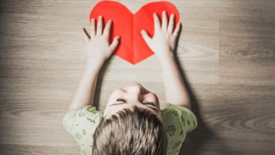A boy with a heart after his mom explains ADHD to him