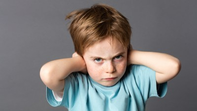 A child acting rudely towards parents who wonder why