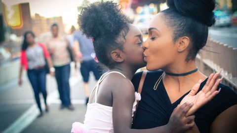 A mom hugs her daughter with ADHD