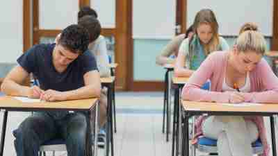 Teens with ADHD taking either the ACT or SAT, sitting at desks in rows