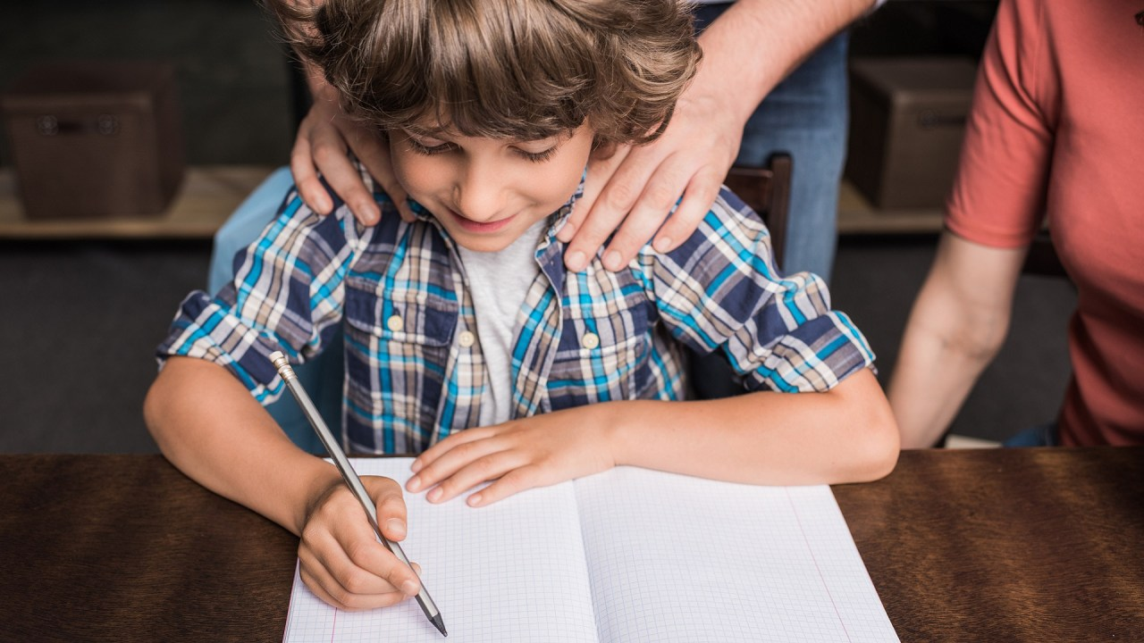 A dad and mom with ADHD help their child with homework