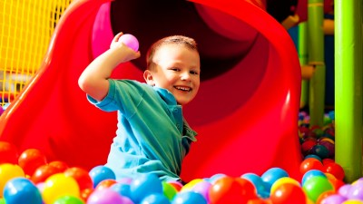 boy playing in a ball pool