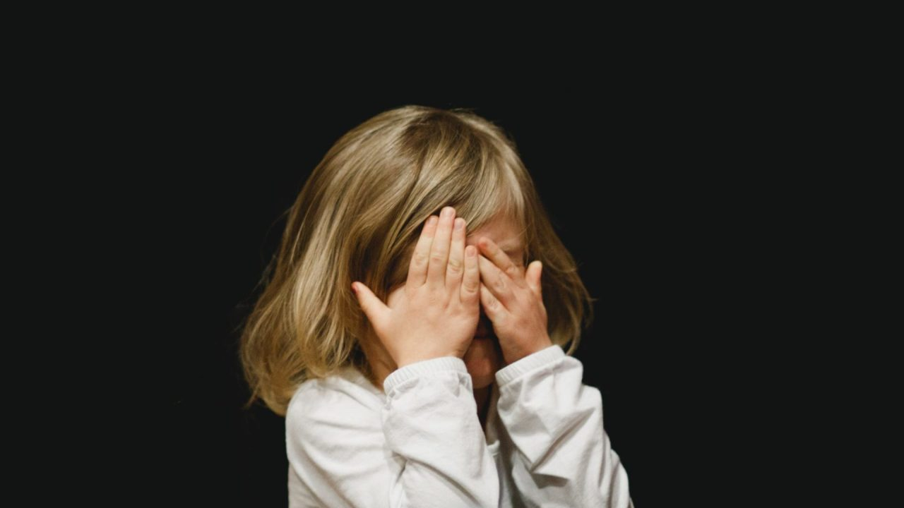 Why lie? Child covers her face after telling a fib