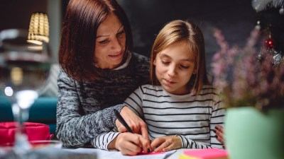 A mother creates instructional scaffolding to help her teen daughter with homework.