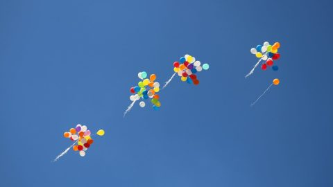 balloons float away, representing the need to let things go in order to maintain a happy adhd marriage