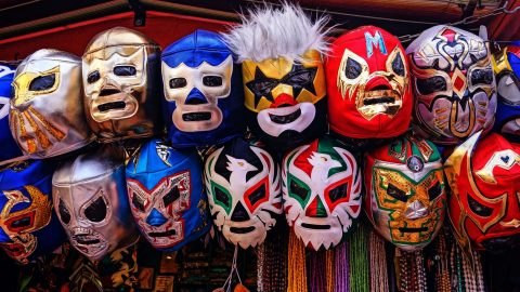 masks on a wall stand in for the way the author feels her adhd hides her true self