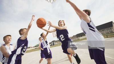 Boys playing basketball