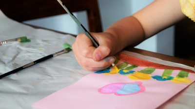An ADHD child draws a picture for her mother.
