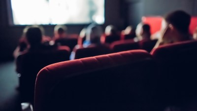 A family watches a movie in a small theater about parenting ADHD boys.
