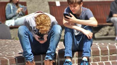Two ADHD teen boys with cell phones