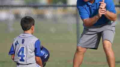 Baseball coach working with athlete with ADHD