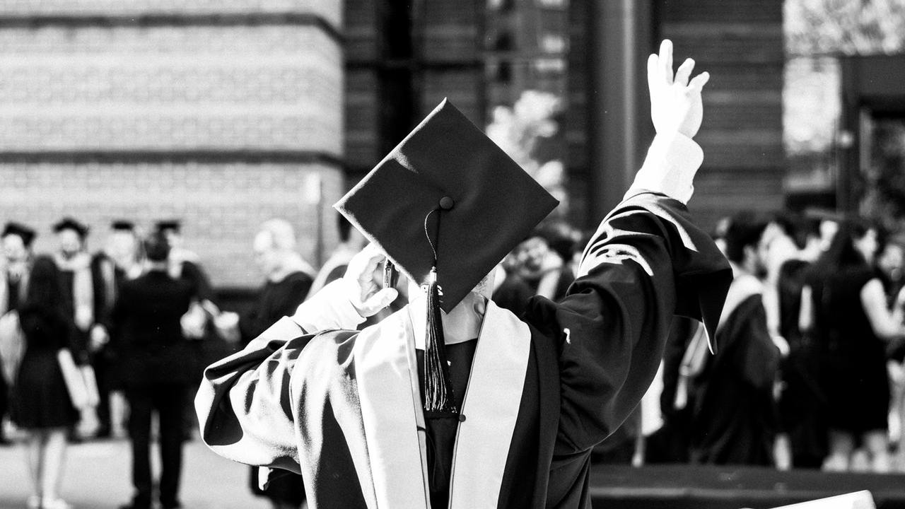 A teen with ADHD at high school graduation
