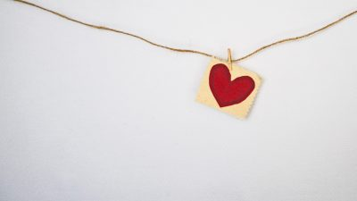 simple necklace with red heart in gold square
