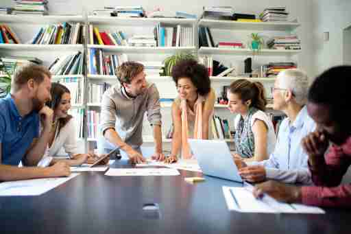 Happiness at workplace: Group of business people at work in office