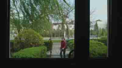 View from inside a home looking out of a family member who refuses to commit to social distancing