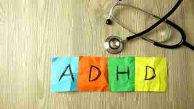 ADHD Attention Deficit Hyperactivity Disorder abbreviation handwritten on sticky notes with stethoscope