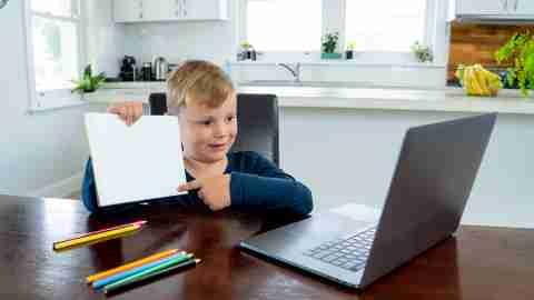 boy in online classroom