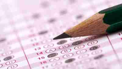 A closeup image of a pencil and a scantron