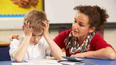 Frustrated school boy and teacher