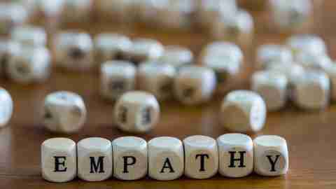 """The word """"empathy"""" arranged in letter blocks"""