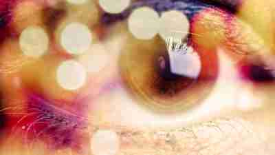 Close up of an eye taking in sensory stimuli