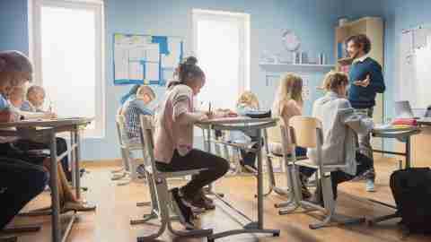Enthusiastic Teacher Explains Lesson to a Classroom