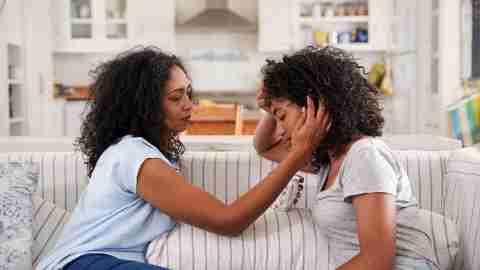 Mother comforting teen daughter