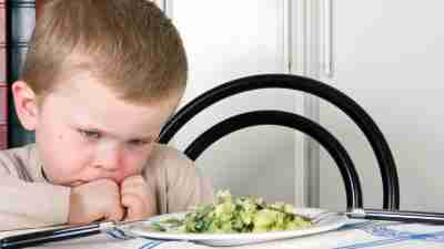 Four year old boy refusing to eat his dinner