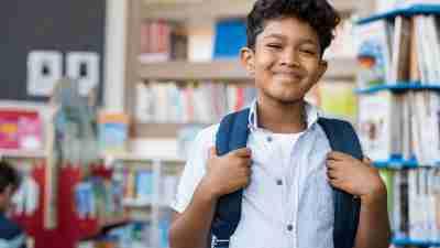 Portrait of smiling hispanicadhd  boy looking at camera.